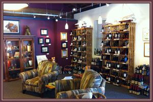 Interior photograph of Bishop\'s Stock Gallery showing a sitting area, wine racks filled with a lot of bottle of wine and artwork hung on surrounding walls.
