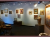 Interior photograph of one of Bishop\'s Stock gallery wall with an elegant display of paintings and sculpture.